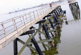 Fiberglass Pipe Jackets on Pier by MFG Construction and Water Products